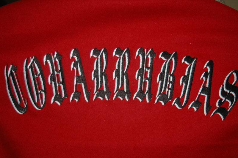 Two color embroidery shadow last name in old english.
