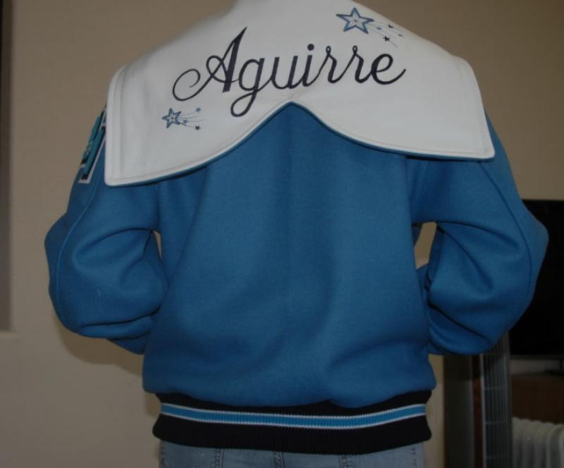 Girls varsity jacket with custom leather hood.