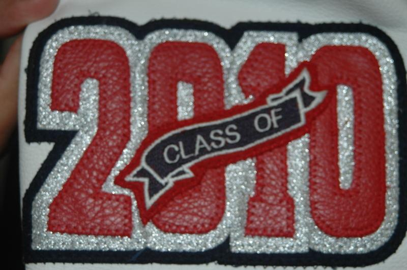 Leather graduating year with metallic silver accent.