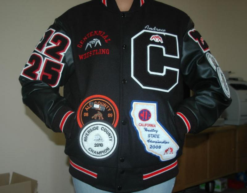 Boys varsity jacket with additional patches.