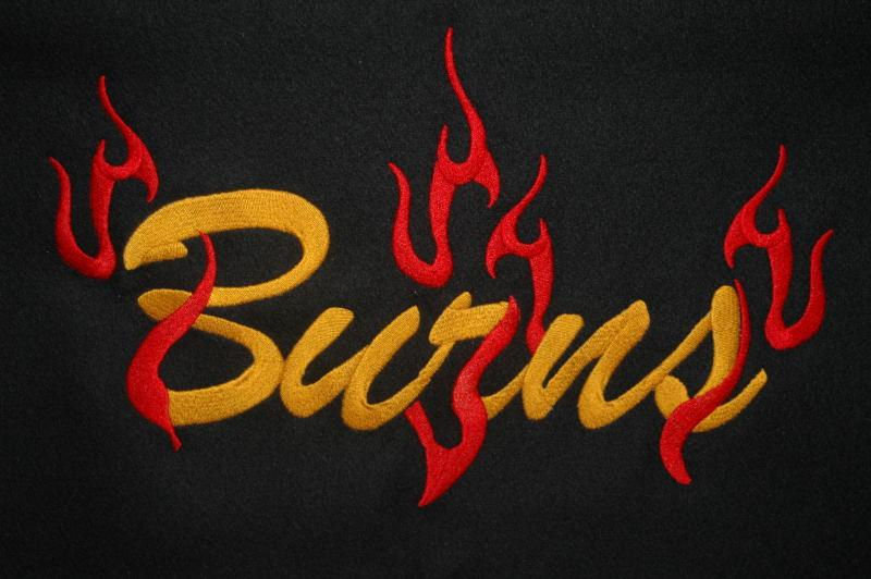 Single color last name with custom flames.