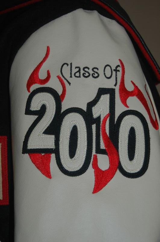 Custom leather graduating year with embroidered flames.
