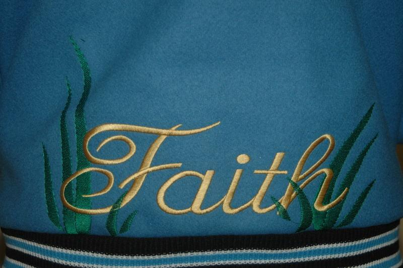 Custom embroidery just above the trim on the jacket of the jacket.