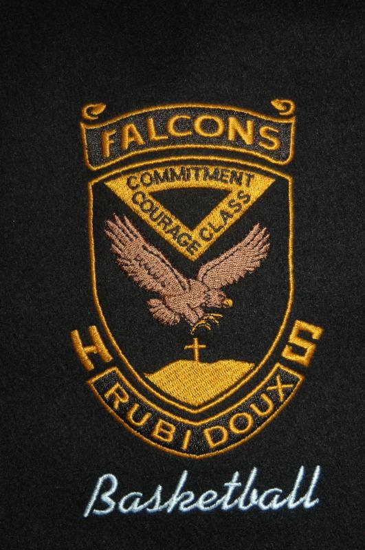 Custom school crest embroidered onto front of jacket.