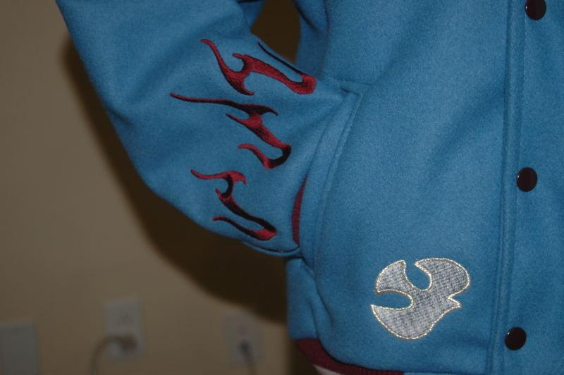 Custom embroidery on wool sleeves down by cuff trim.